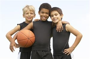 Children posing with basketball